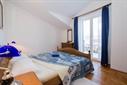 Apartman E za 6  osoba u kući Marina